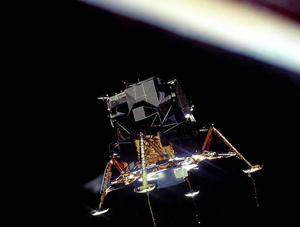 The Apollo 11 Lunar Module Eagle, in a landing configuration was photographed in lunar orbit from the Command and Service Module Columbia. Inside the module were Commander Neil A. Armstrong and Lunar Module Pilot Buzz Aldrin. The long rod-like protrusions under the landing pods are lunar surface sensing probes. Upon contact with the lunar surface,