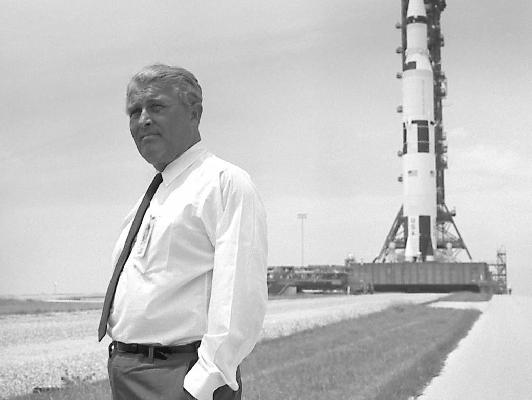 Dr. Wernher von Braun pauses in front of the Saturn V vehicle being readied for the historic Apollo 11 lunar landing mission.