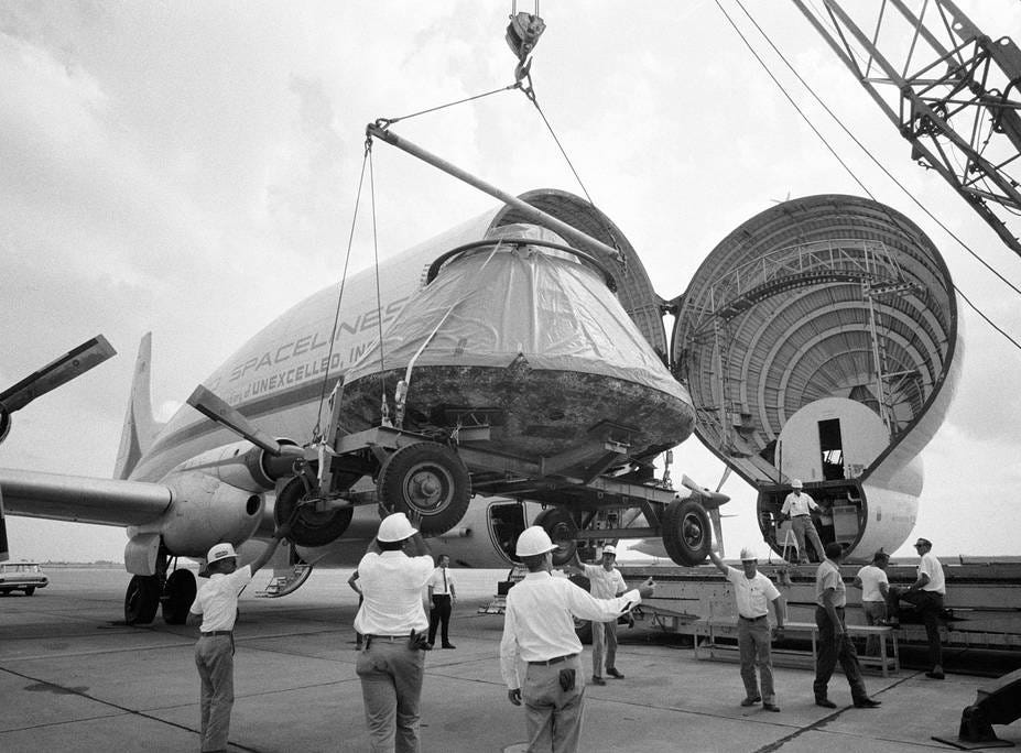 The Apollo 11 spacecraft Command Module (CM) is loaded aboard a Super Guppy Aircraft at Ellington Air Force Base for shipment to the North American Rockwell Corporation at Downey, Calif. The CM was just released from its postflight quarantine at the Manned Spacecraft Center (which would later be renamed JSC).