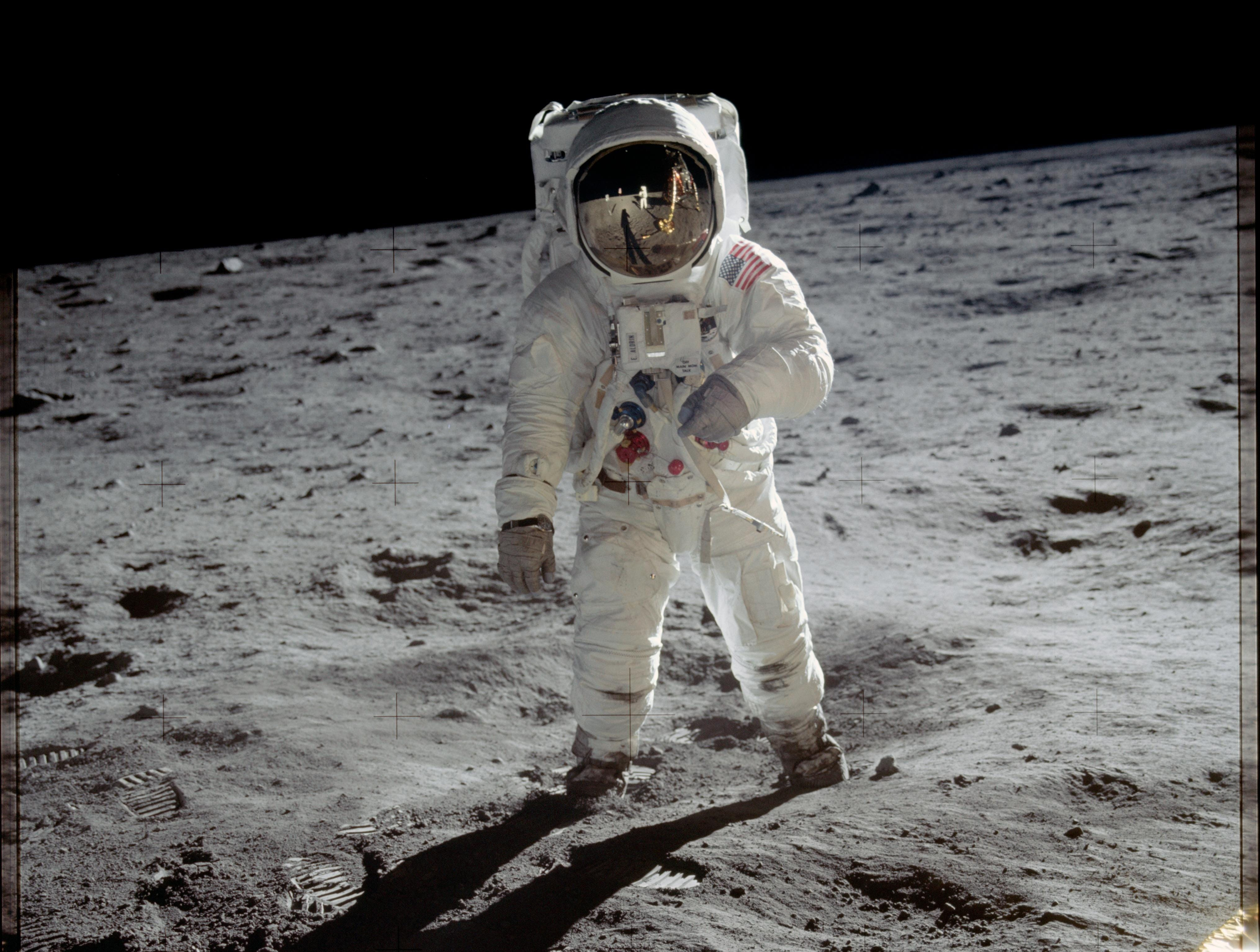 Astronaut Buzz Aldrin walks on the surface of the moon near the leg of the lunar module Eagle during the Apollo 11 mission. Mission commander Neil Armstrong took this photograph with a 70mm lunar surface camera.