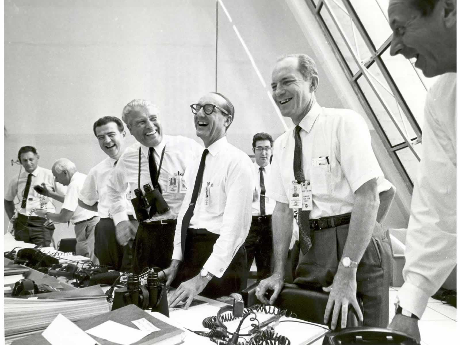 Apollo 11 mission officials relax in the Launch Control Center following the successful Apollo 11 liftoff on July 16, 1969.