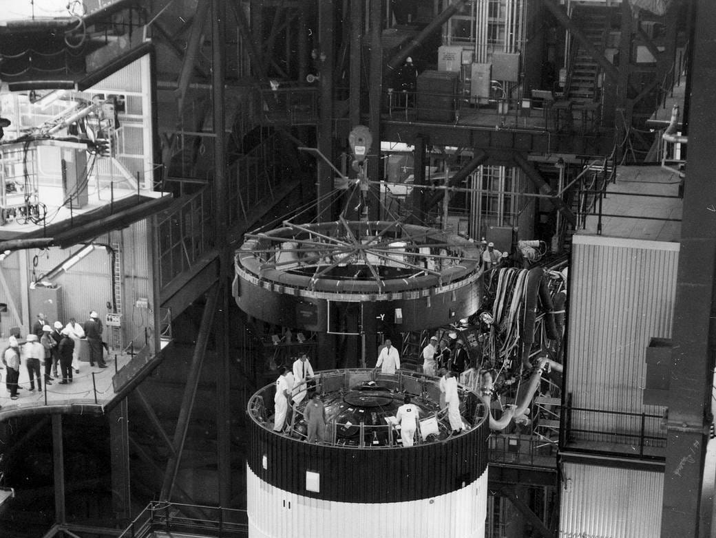 This week in 1969, Apollo 11 launched from NASA's Kennedy Space Center. Here, the Instrument Unit is lowered into place atop the third stage of the Saturn V launch vehicle in the Vehicle Assembly Building at Kennedy.
