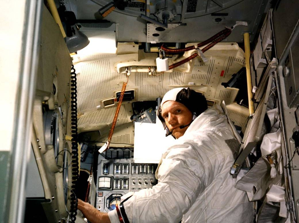 Neil A. Armstrong, commander for the Apollo 11 moon-landing mission, practices for the historic event in a lunar module simulator in the Flight Crew Training Building at Kennedy.