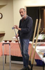 Mark Johnson, an avid compost creatorfrom Lexington,shared his gardening secrets including this weeding device, with members ofthe Earth, Wind and Flowers Garden Club March 4.