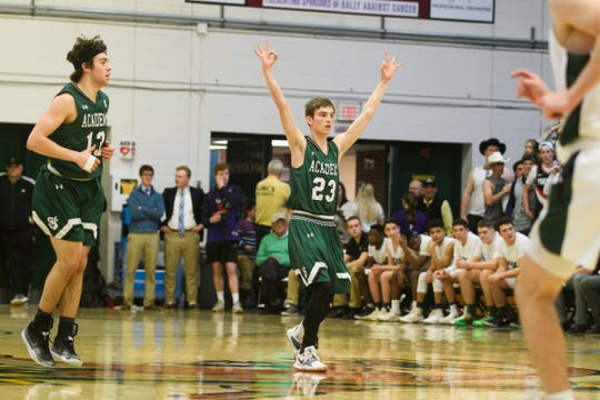 St. Johnsbury's Logan Wendell (23) celebrates after making three pointer during the boys DI semifinal basketball game between the St. Johnsbury Hilltoppers and the Rice Green Knights at Patrick Gym on Monday night March 11, 2019 in Burlington, Vermont.