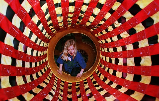 Lindsay Fitzpatrick, 7, of Colchester climbs through a jungle gym at Pizza Putt in South Burlington in 1998.