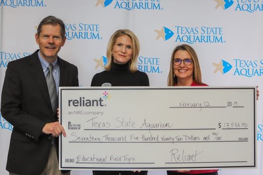 Left to right: Tom Schmid, president and  CEO, Texas State Aquarium; Courtney McLain, vice president of development, Texas State Aquarium; Leanne Schneider, director, community relations and executive director, Reliant Charitable Foundation