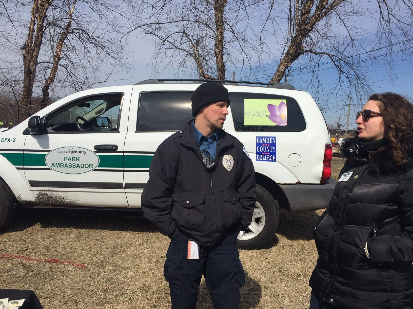 Security personnel called park ambassadors roam Gateway Park on opening day. Ambassador Matt Crandall        talks with Julia  Raskin of the New Jersey Conservation Foundation, which  managed the park for Camden County and the county  municipal utilities authority