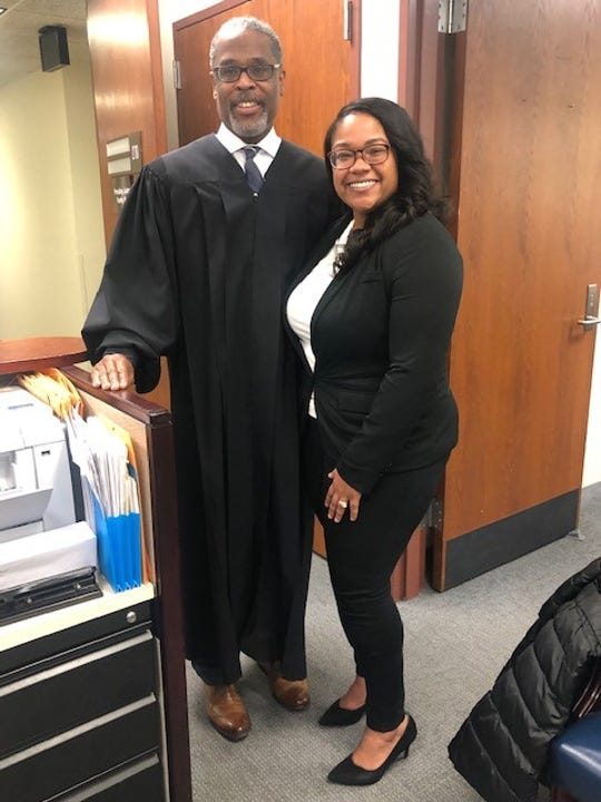 Carmen Day, a law student at Rutgers-Camden, shares a smile with Judge Charles Dortch. Day credits Dortch with helping her stay on track to fulfill her dream of becoming a lawyer.