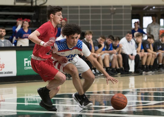 Zane Trace guard Cam Evans dribbles the ball during a 51-45 win over Fairfield Union in a Division II district final game at Ohio University's Convocation Center in Athens, Ohio, on March 10, 2019.
