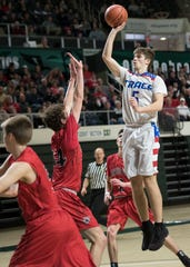 Zane Trace's Nick Nesser shoots the ball during a 51-45 win over Fairfield Union in a Division II district final game at Ohio University's Convocation Center in Athens, Ohio, on March 10, 2019.