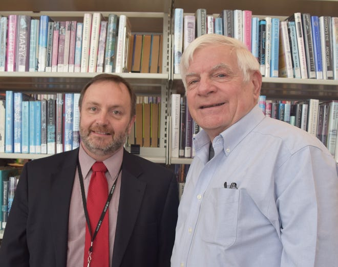 """Steve Mayhugh, MidPointe Library West Chester director, left, and Jack Dominic, director of the National Voice of America Museum of Broadcasting, host """"History of the VOA-Bethany Station and the VOA Museum Today"""" Wednesday, April 3."""