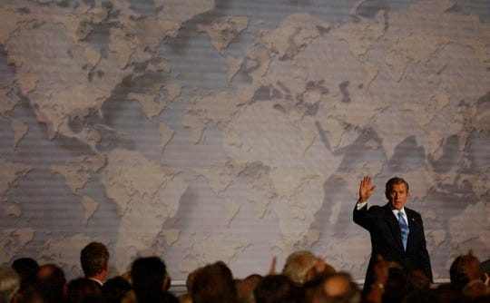 Waving from the stage of Union Terminal Museum Center President George W. Bush spoke about the threat facing the world concerning Iraq on Oct. 7, 2002.