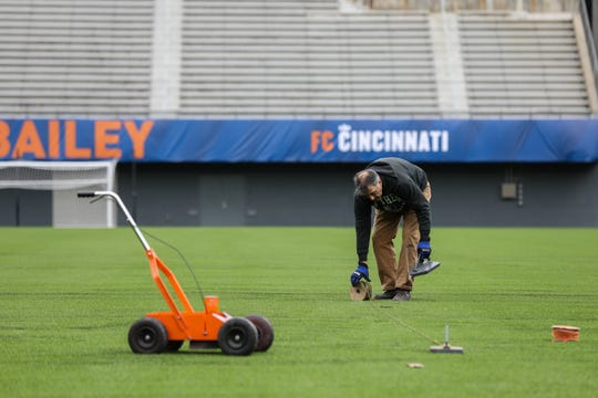 Nippert Stadium is having the field lines painting for the first home MLS FC Cincinnati match on Saturday March 17. James Hlavaty and Chris Fiore of Pioneer Turf Services set up guides and spray down the lines on the field. The field also recieved a few new banners.