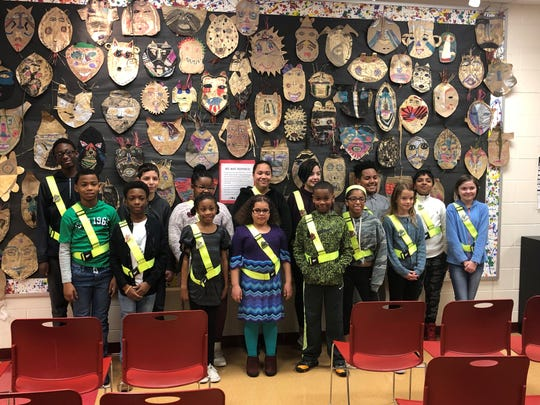 North Avondale Montessori Elementary School students recently promoted to captains and lieutenants in the AAA School Safety Patrol Program.