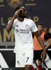 Mar 10, 2019; Atlanta, GA, USA; FC Cincinnati forward Roland Lamah (7) celebrates his goal in the second half against the Atlanta United at Mercedes-Benz Stadium.