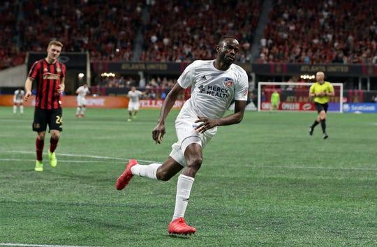 Mar 10, 2019; Atlanta, GA, USA; FC Cincinnati forward Roland Lamah (7) celebrates after scoring a goal in the second half against the Atlanta United at Mercedes-Benz Stadium.