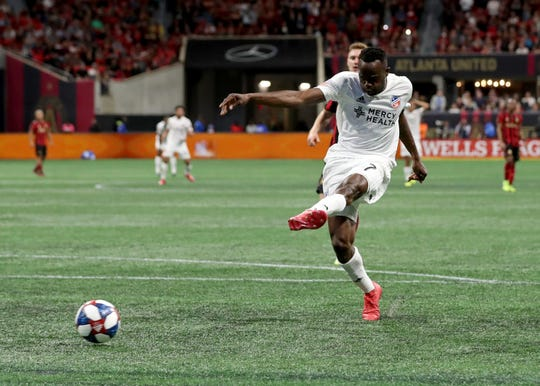 Mar 10, 2019; Atlanta, GA, USA; FC Cincinnati forward Roland Lamah (7) scores a goal in the second half against the Atlanta United at Mercedes-Benz Stadium.