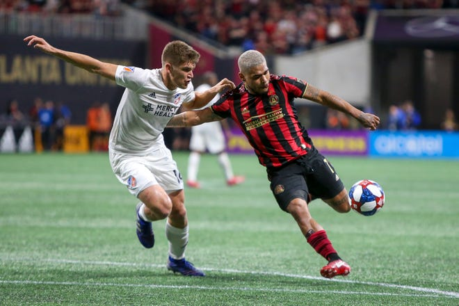 Mar 10, 2019; Atlanta, GA, USA; FC Cincinnati defender Nick Hagglund (14) defends Atlanta United forward Josef Martinez (7) in the second half at Mercedes-Benz Stadium.
