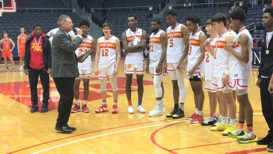 Purcell Marian Cavaliers are presented their Division III district championship trophy, March 10, 2019, UD Arena.
