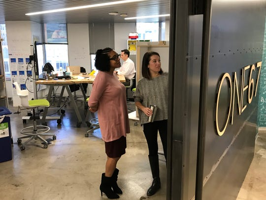 Kimberly Brown (left) and Katie Dreyer at work in Fifth Third Bank's ONE67 innovation center at the Downtown Cincinnati headquarters.