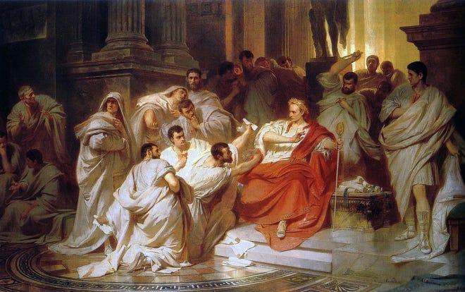 The senators encircle Julius Caesar in a painting by 19th-century artist Carl Theodor von Piloty.