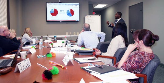 Donald Harris, SAMHSA project associate, leads a group discussion at Clarksville City Hall last week  as part of the Mayor's Challenge to Prevent Suicide Among Service Members, Veterans  and their Families. The group is working to establish a suicide prevention strategic plan for Clarksville.