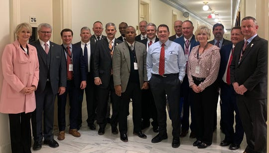 Citizens for Fort Campbell delegates meet with Rep. Mark Green, center wearing blue, in Washington, D.C., in February 2019.