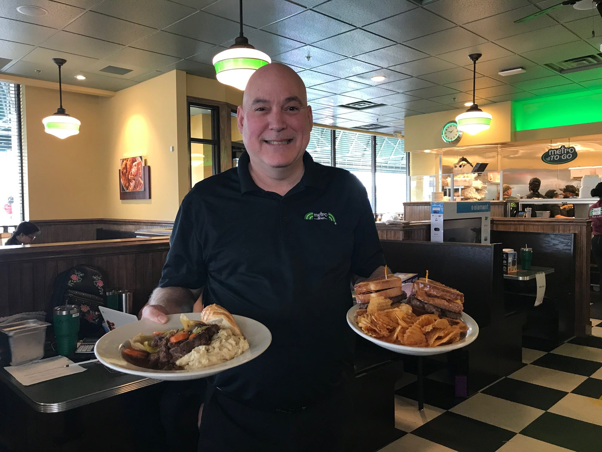 Managing Partner Michael Killeen shows off some of the dishes at Metro Diner in East Brunswick.