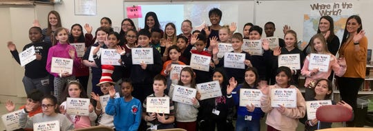 Meteorologists Andrea Romero of Telemundo 47 and Janice Huff of News 4 New York with fourth-graders and staff from School No. 8 in Linden.
