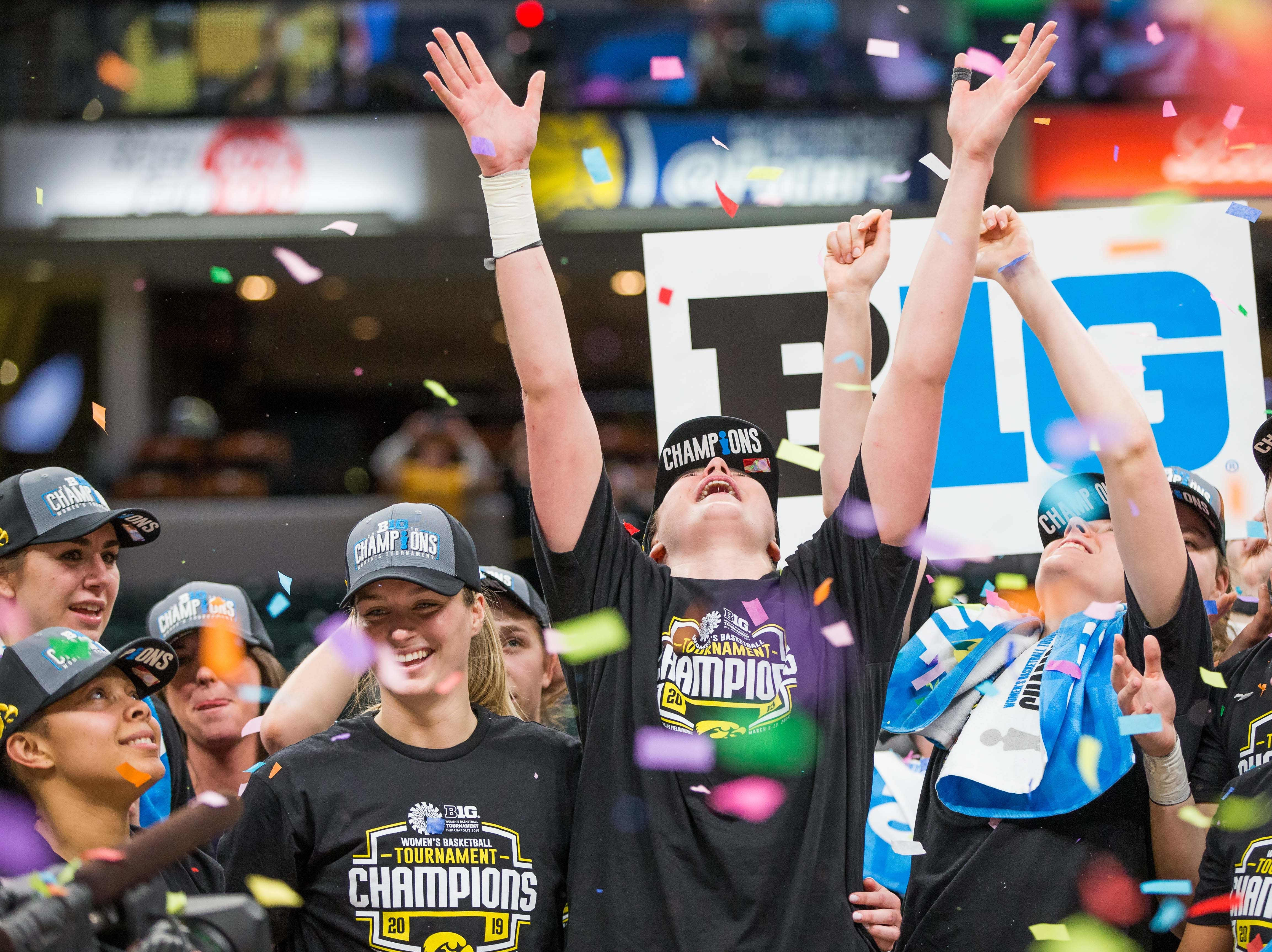 Iowa Hawkeyes forward Megan Gustafson (10) celebrates the championship victory after the game against the Maryland Terrapins in the women's Big Ten Conference Tournament at Bankers Life Fieldhouse.