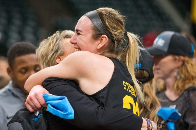Iowa Hawkeyes forward Hannah Stewart (21) and head coach Lisa Bluder  celebrates the championship victory after the game against the Maryland Terrapins in the women's Big Ten Conference Tournament at Bankers Life Fieldhouse.