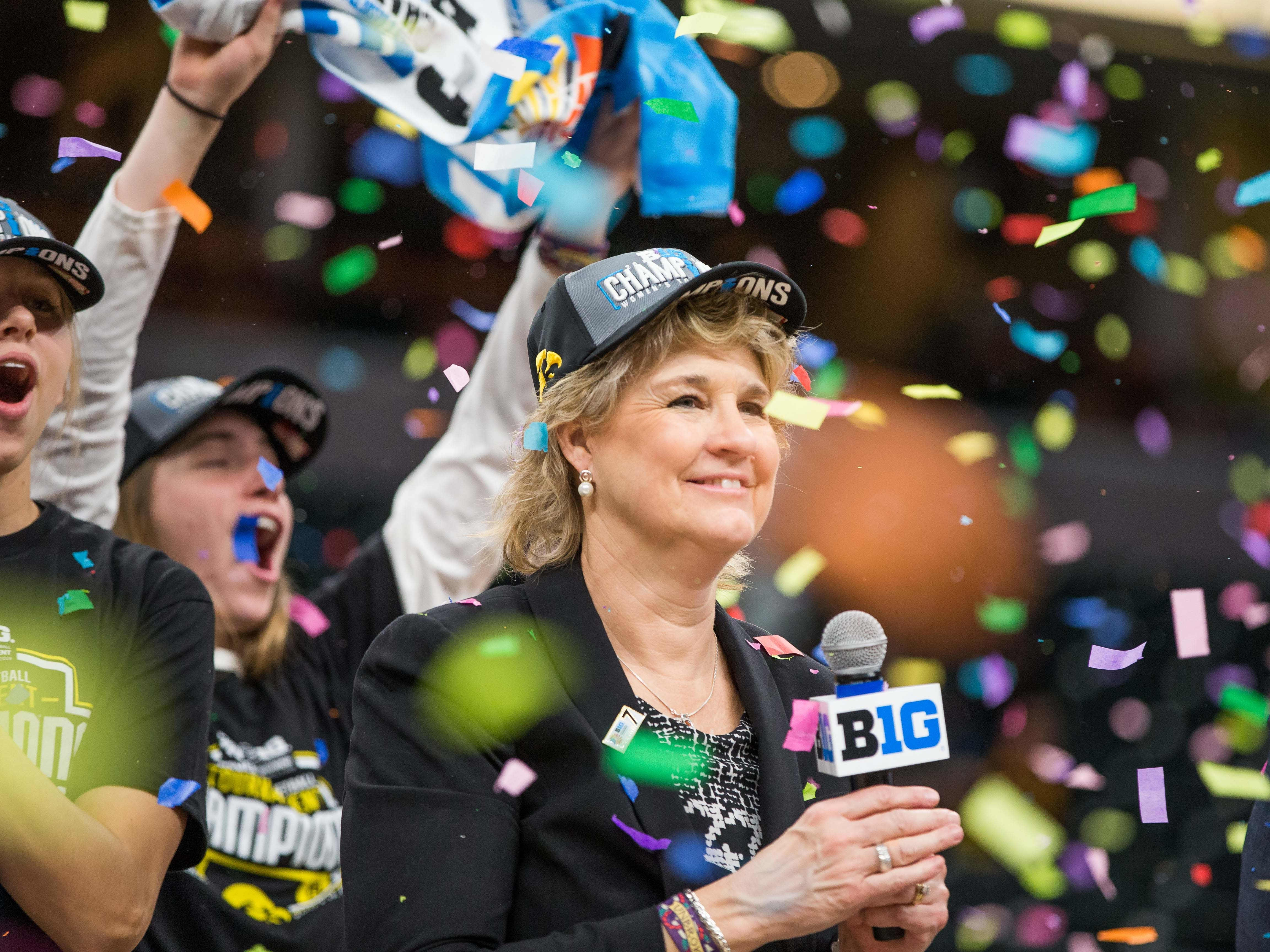 Iowa Hawkeyes head coach Lisa Bluder celebrates the championship victory after the game against the Maryland Terrapins in the women's Big Ten Conference Tournament at Bankers Life Fieldhouse.
