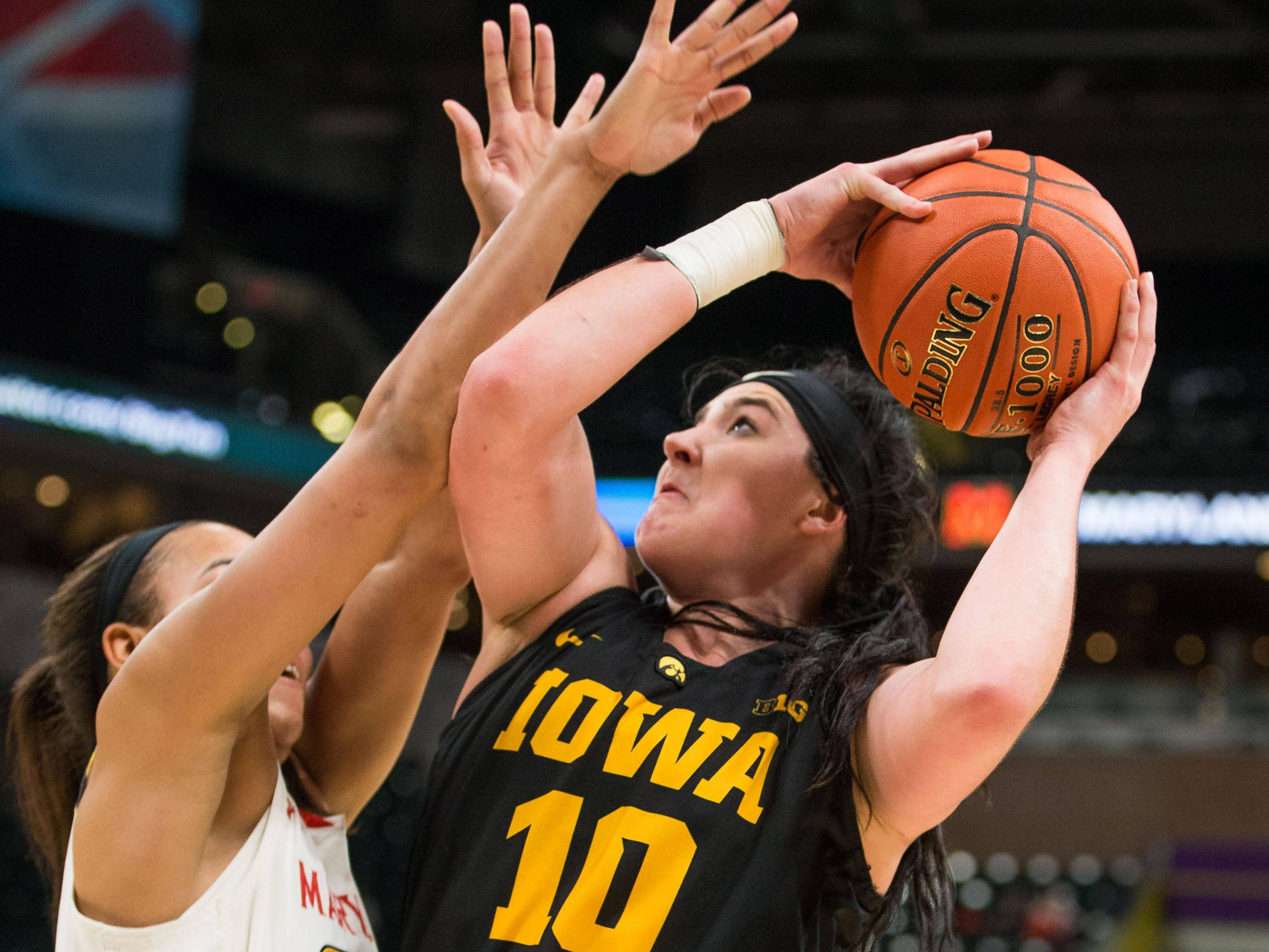 Iowa Hawkeyes forward Megan Gustafson (10) shoots the ball over Maryland Terrapins forward Stephanie Jones (24) in the second half in the women's Big Ten Conference Tournament at Bankers Life Fieldhouse.