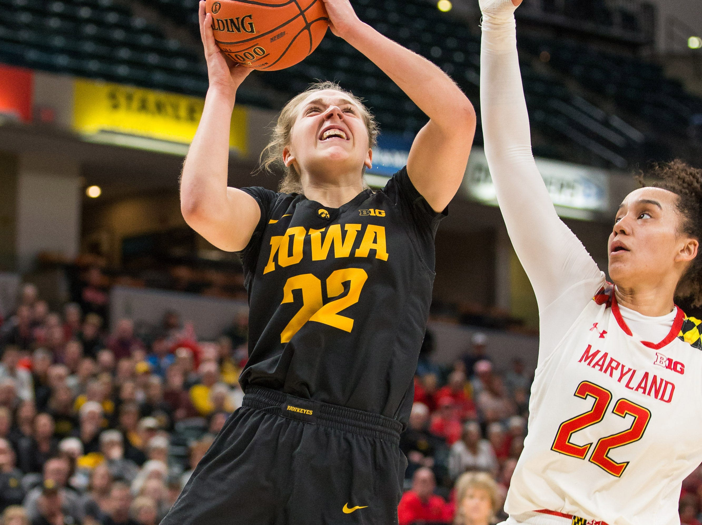 Iowa Hawkeyes guard Kathleen Doyle (22) shoots the ball over Maryland Terrapins guard Blair Watson (22) in the second half in the women's Big Ten Conference Tournament at Bankers Life Fieldhouse.