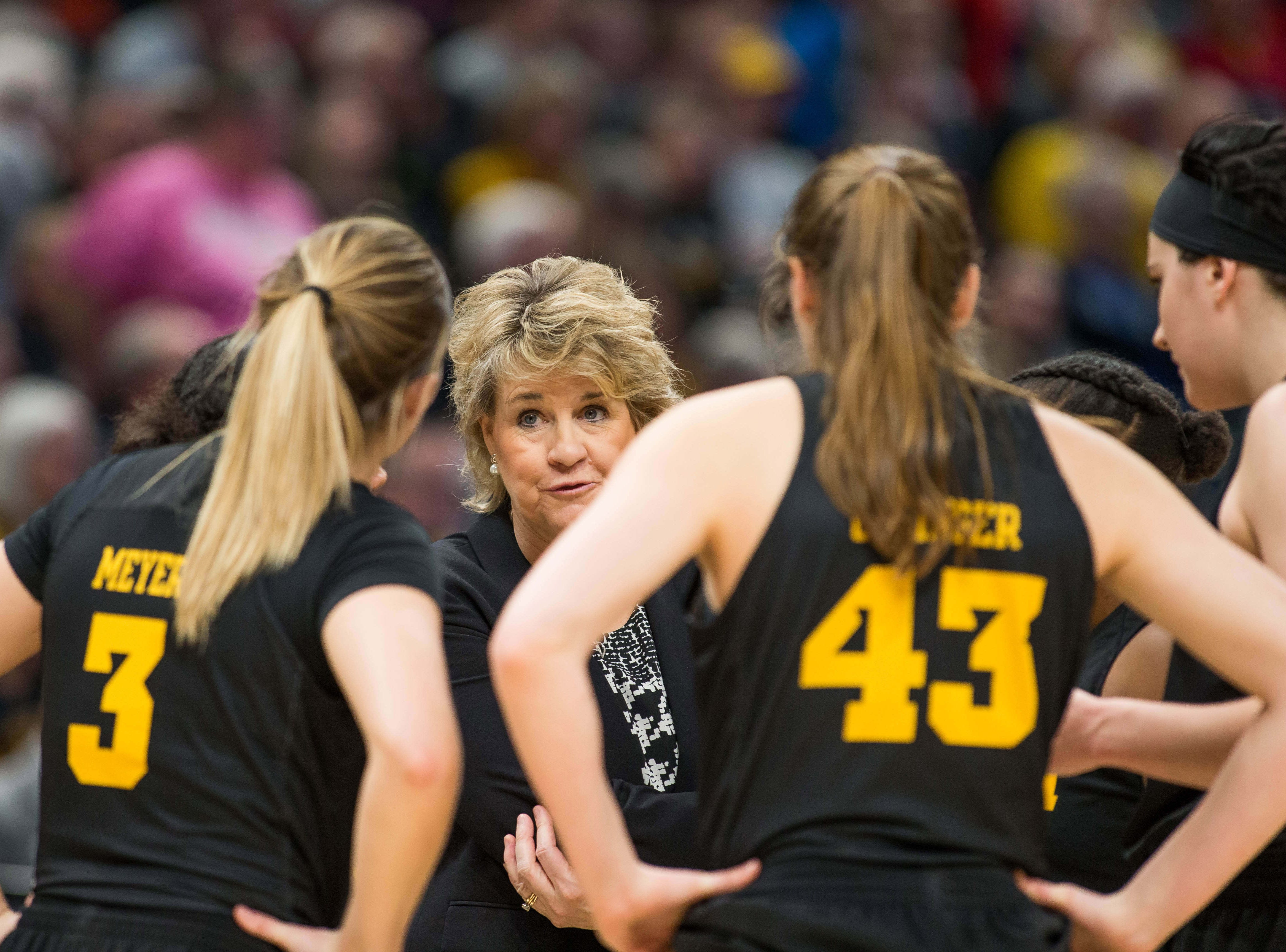 Iowa Hawkeyes head coach Lisa Bluder talks to her team during a timeout in the second half against the Maryland Terrapins in the women's Big Ten Conference Tournament at Bankers Life Fieldhouse.