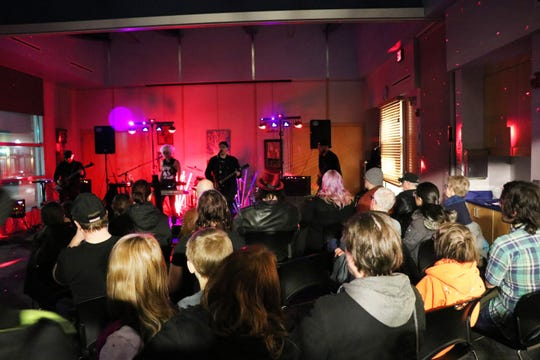 About 75 people listen to a rock band performance on March 1 at the Ferndale Public Library, in a concert funded by donations. Live music keeps young people involved, librarians say.