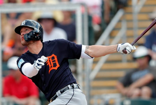 Tigers left fielder JaCoby Jones follows through on a two-run home run in the fifth inning of a spring training baseball game against the Twins Monday, March 11, 2019, in Fort Myers, Fla.