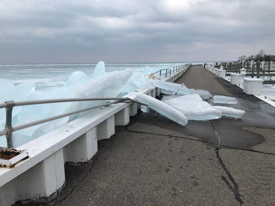 Ice from Lake St. Clair appears to have damaged a railing at Pier Park in Grosse Pointe Farms on Sunday, March 10, 2019.