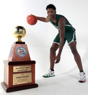 New Haven H.S. senior Romeo Weems with the Hal Schram Mr. Basketball trophy Monday, March 11, 2019 in Detroit, Mich.