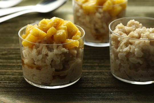A batch of Instant Pot rice pudding takes a mere 10 minutes -- three of those under pressure -- and yields perfectly tender, not mushy, grains of rice. We top them with glazed pineapple for a sweet-tart contrast to the richness. (E. Jason Wambsgans/Chicago Tribune/TNS)