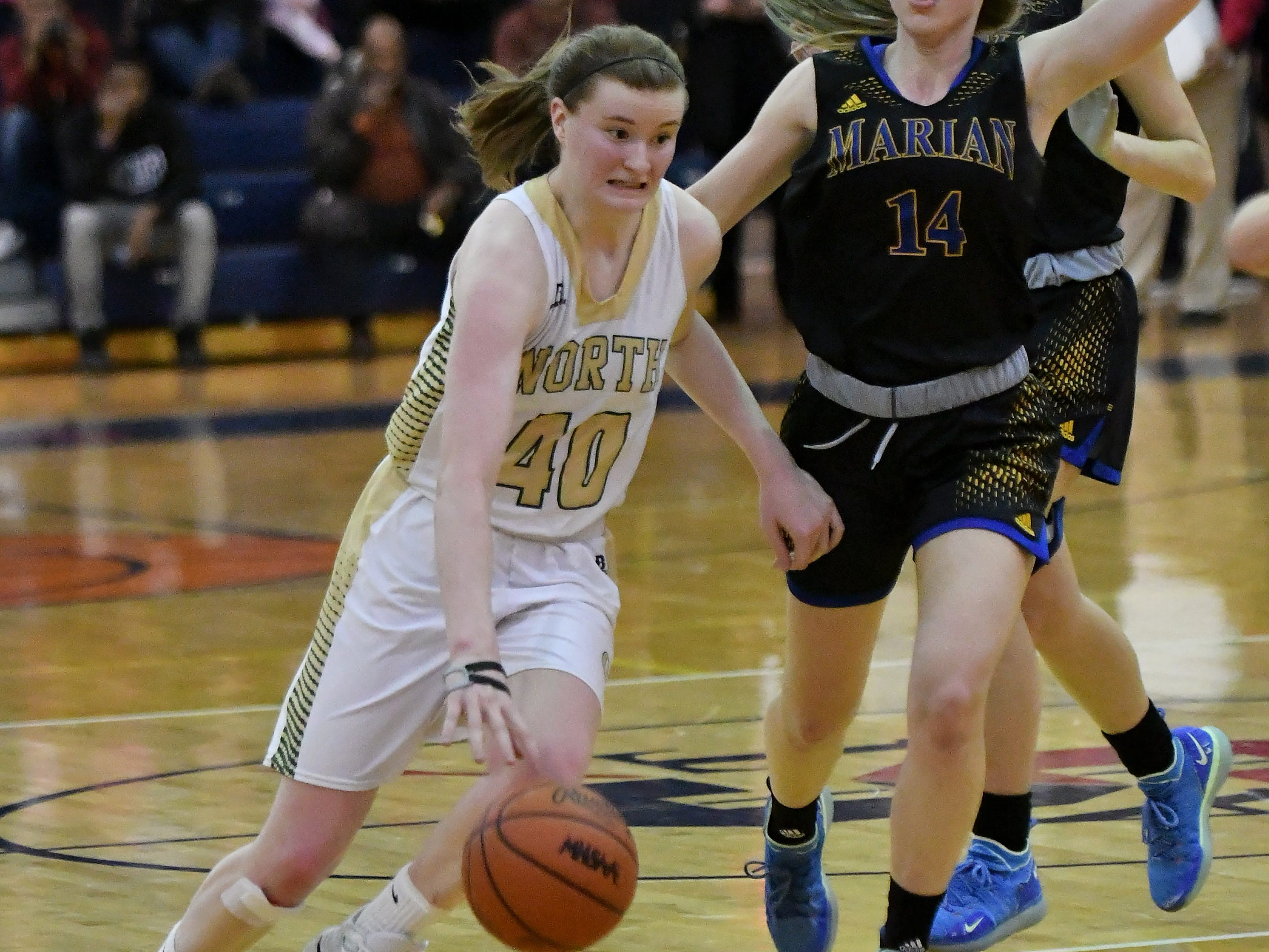 Marian's Grace Rottter (14) chases Grosse Pointe North's Julia Ayrault (40) in the second half.