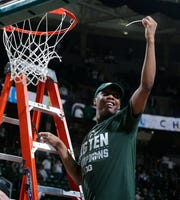 Michigan State guard Cassius Winston helps cut down the net after the Big Ten title-clinching win over Michigan.