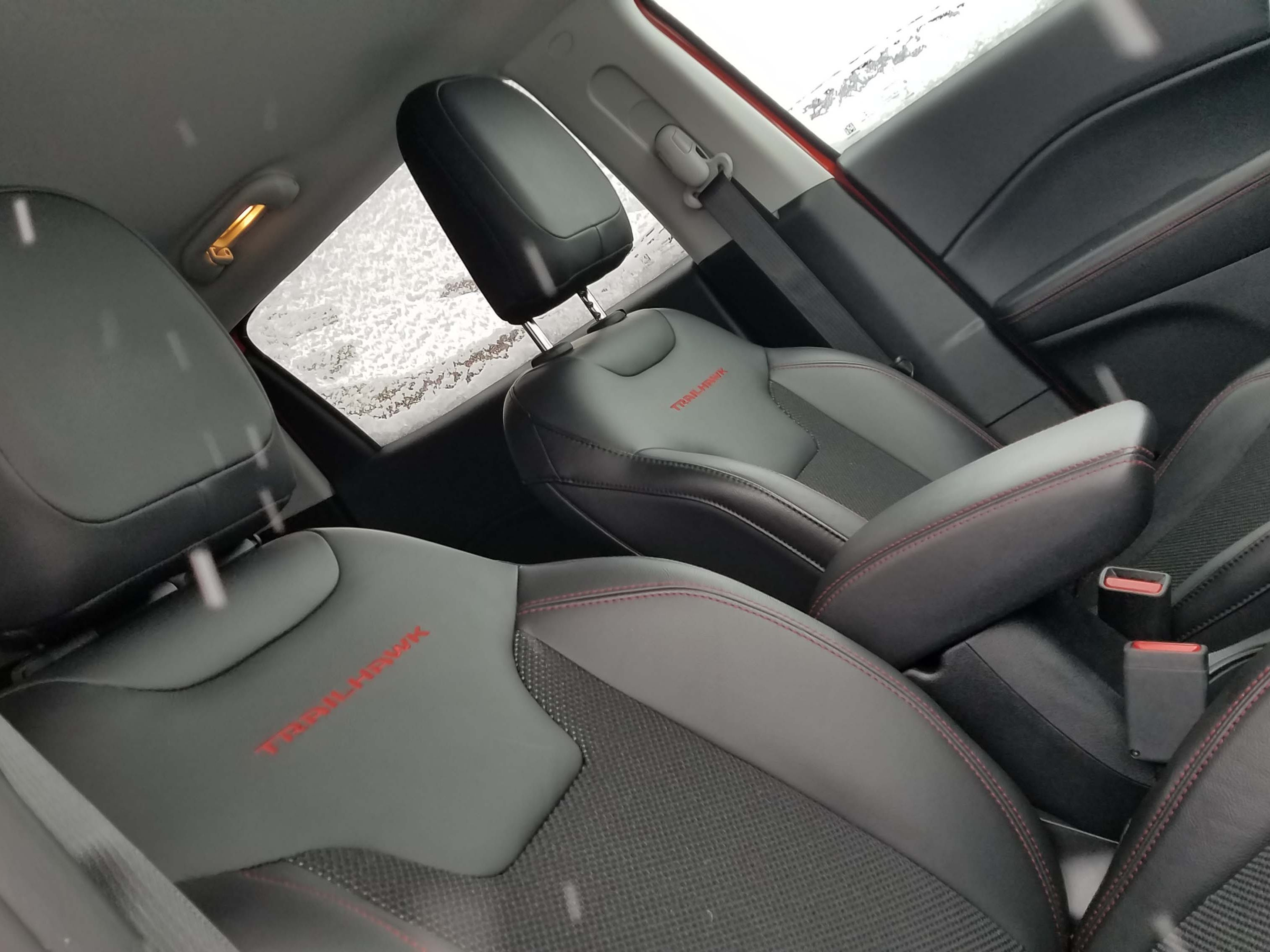 The Jeep Compass Trailhawk comes with black trim outside — and nicely monogrammed seats inside.
