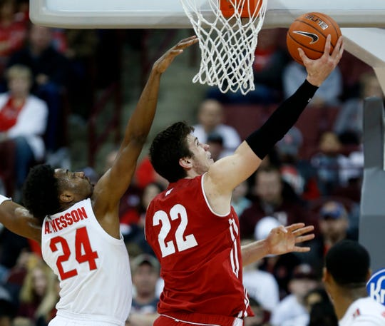 Wisconsin forward Ethan Happ, right, goes up for a shot against Ohio State forward Andre Wesson during the second half.