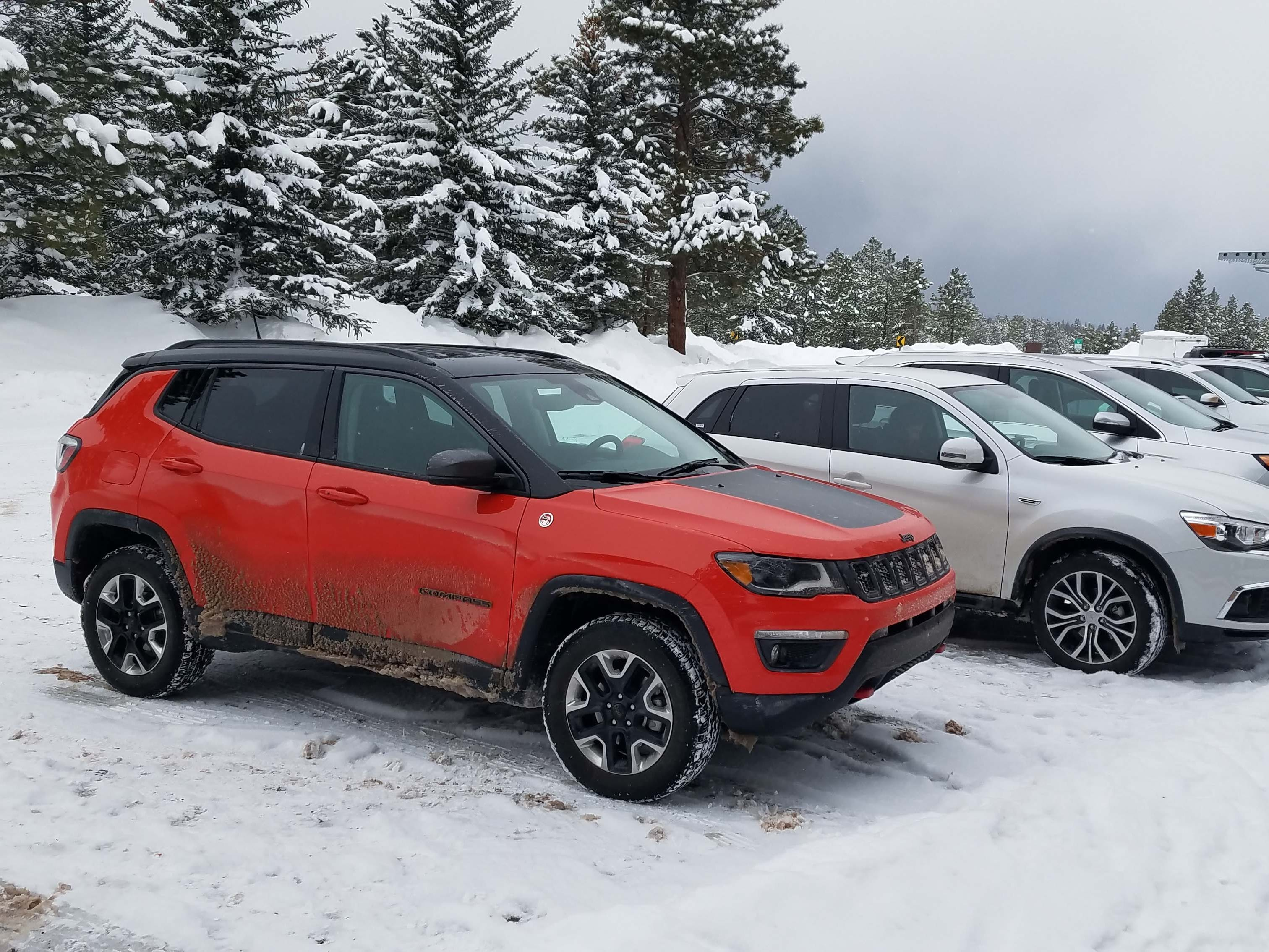 The cure for the common ute. The Jeep Compass Trailhawk stands out in a parking lot of SUVs at Bryce Canyon.