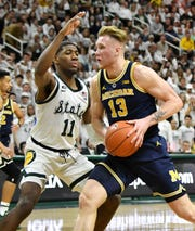 Aaron Henry (11) and Michigan State are a No. 2 seed in the latest round of bracket projections, while Michigan and   Ignas Brazdeikis (13) are a No. 3 seed.