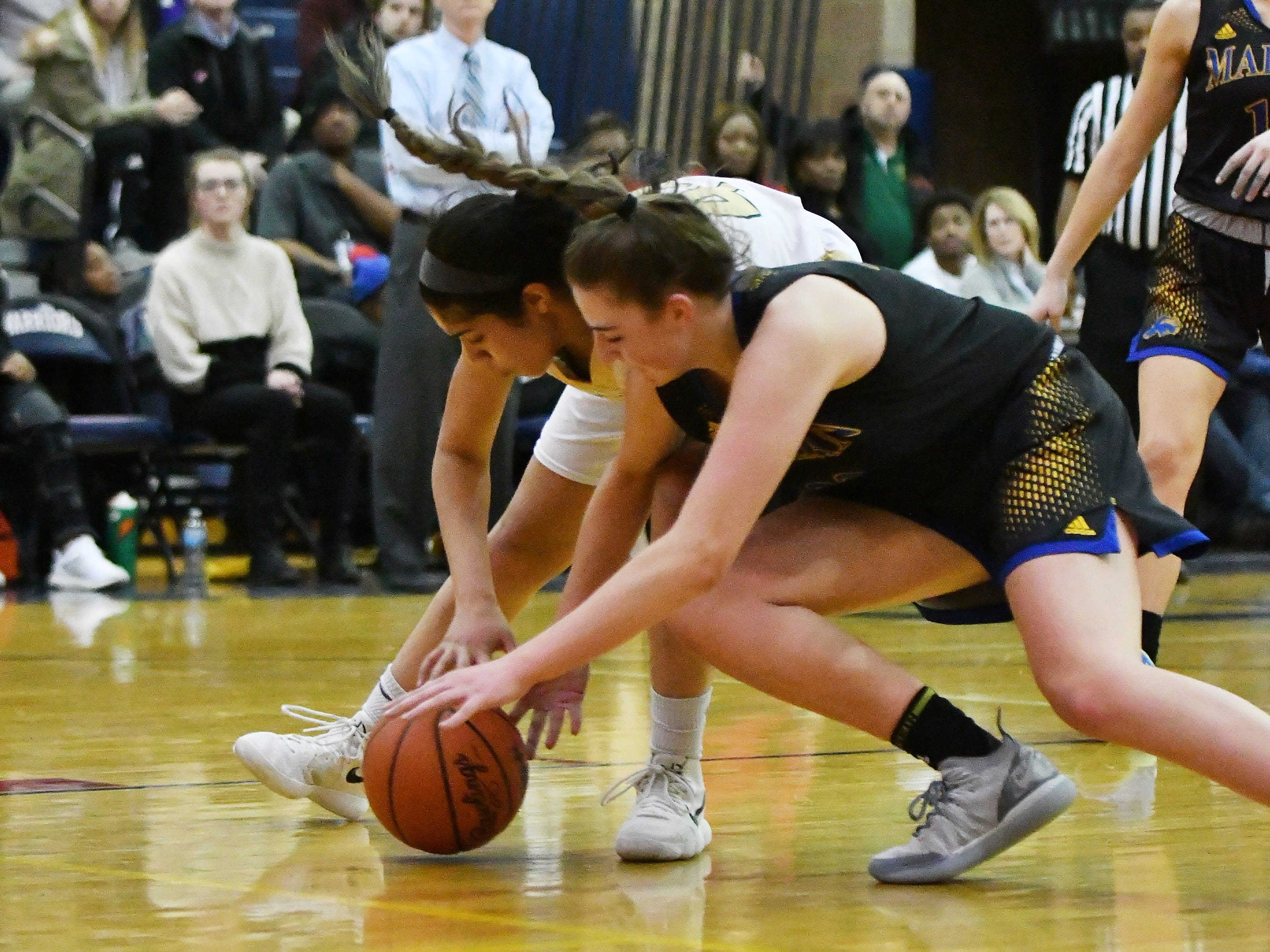 Marian's Lauren Licari and Grosse Pointe North's Christina Braker, rear, in the second half.