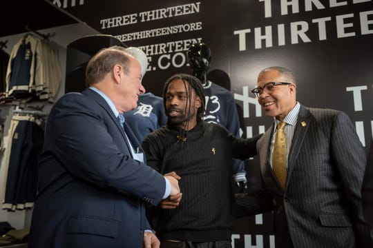 "(From left) Detroit Mayor Mike Duggan, Clement ""Fame"" Brown Jr., Founder of Three Thirteen, and Detroit police chief James Craig, inside the store on Livernois, in Detroit, March 11, 2019.  The clothing store recently became the 500th business to adopt the Project Green Light community safety program."