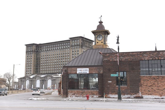 Cork & Gabel rests in the shadow of the Michigan Central Train Depot (left) along Michigan Avenue in Detroit's Corktown on Thursday, March 7, 2019.